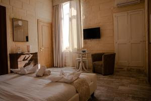 A bed or beds in a room at Point de vue