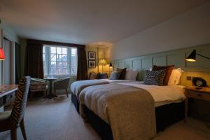 A bed or beds in a room at The Bear Esher