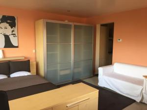 Un ou plusieurs lits dans un hébergement de l'établissement Residence la Fraisiere