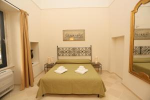 Letto o letti in una camera di Villa Lucrezio Resort