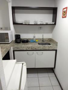 A cozinha ou cozinha compacta de Pipa's Bay Apartamentos