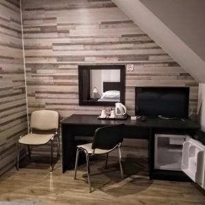 Телевизор и/или развлекательный центр в Mini-hotel Anhalt