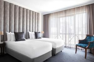 A bed or beds in a room at Mantra on Russell