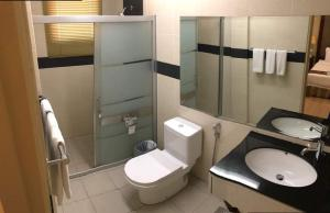 A bathroom at The Capital Residence Suites