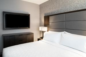 A bed or beds in a room at Staybridge Suites - Quincy, an IHG Hotel
