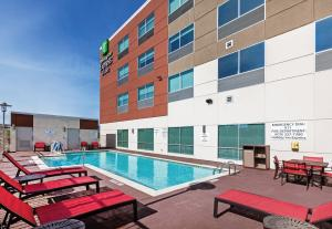 The swimming pool at or near Holiday Inn Express & Suites - Brenham South