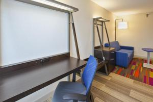 A television and/or entertainment center at Holiday Inn Express & Suites Chicago-Midway Airport