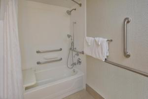 A bathroom at Holiday Inn Express & Suites Chicago-Midway Airport