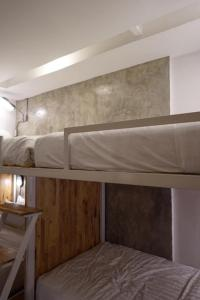 A bunk bed or bunk beds in a room at Sabai Nimman