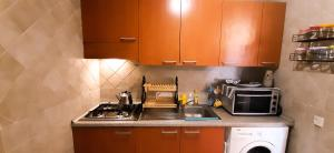 A kitchen or kitchenette at CAPRICE FLAT