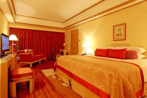 A bed or beds in a room at Taj Samudra