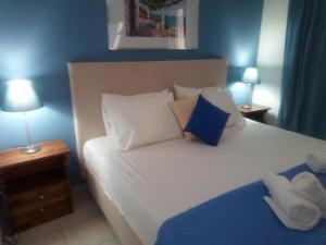 Ένα ή περισσότερα κρεβάτια σε δωμάτιο στο Cristal Studios