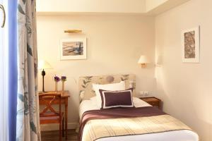 Кровать или кровати в номере Le Relais Madeleine