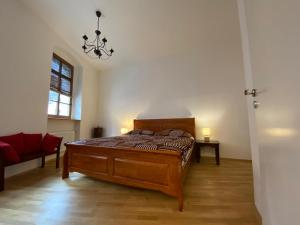 A bed or beds in a room at Apartmán Hubertus