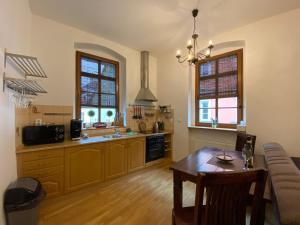 A kitchen or kitchenette at Apartmán Hubertus