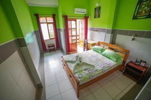 Cama o camas de una habitación en Hotel Takana