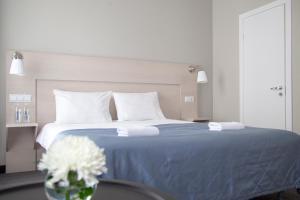 Кровать или кровати в номере Невский Астер