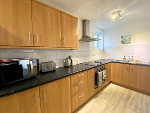 A kitchen or kitchenette at Simpson Beach View Apartments