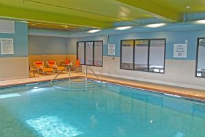 The swimming pool at or near Holiday Inn Express & Suites - St. Louis South - I-55