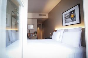 Un ou plusieurs lits dans un hébergement de l'établissement Mercure Rennes Centre Place Bretagne