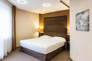 Кровать или кровати в номере Парк Инн от Рэдиссон Саду