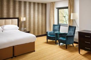 A bed or beds in a room at Delta Hotels Nottingham Belfry