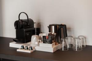 Coffee and tea making facilities at MY HOTEL MALMEDY