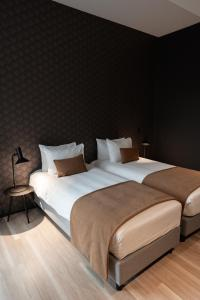 A bed or beds in a room at MY HOTEL MALMEDY
