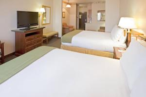 A bed or beds in a room at Holiday Inn Express Hotel & Suites Eagle Pass, an IHG hotel