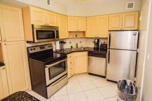 A kitchen or kitchenette at The Alexander All Suites Hotel