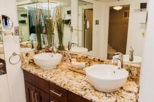 A bathroom at The Alexander All Suites Hotel