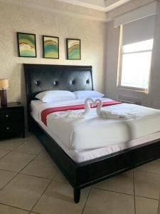 A bed or beds in a room at Vistas de San Juan