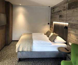 Ein Bett oder Betten in einem Zimmer der Unterkunft Seehotel im Weyer