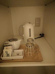 Coffee and tea-making facilities at Bayside Square Kaike Hotel