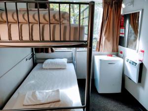 A bed or beds in a room at YMCA Hostel