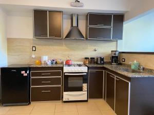 A kitchen or kitchenette at Mendoza Apartments Ezeiza Airport