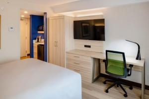 A television and/or entertainment center at Holiday Inn Express & Suites Halifax - Bedford