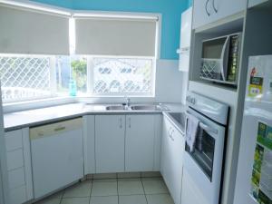 A kitchen or kitchenette at Le Lavandou Holiday Apartments
