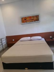 A bed or beds in a room at Manu Sekuta