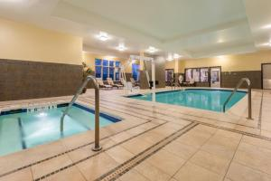 The swimming pool at or close to Holiday Inn Hotel & Suites Grand Junction-Airport