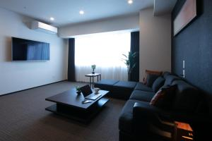A seating area at Randor Residential Hotel Sapporo Suites