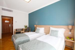 A bed or beds in a room at Medos Hotel