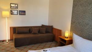 Ein Sitzbereich in der Unterkunft Parkhotel Senftenberg