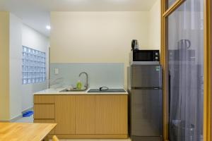 A kitchen or kitchenette at Aspire Saigon
