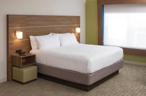 A bed or beds in a room at Holiday Inn Express Hotel & Suites White River Junction