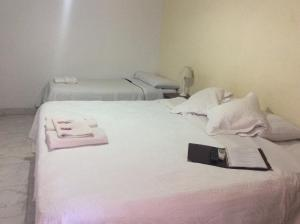A bed or beds in a room at La Ramada