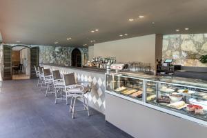Een restaurant of ander eetgelegenheid bij Lopesan Villa del Conde Resort & Thalasso