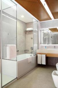 A bathroom at Grand Cosmopolitan Hotel
