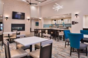 A restaurant or other place to eat at Homewood Suites Des Moines Airport