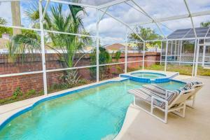The swimming pool at or close to Magical Creekside Villa by IPG Florida